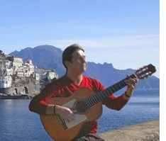 Bob playing the guitar in Amalfi.